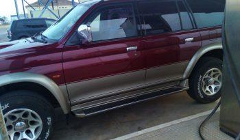 Mitsubishi Sport Granate lleno